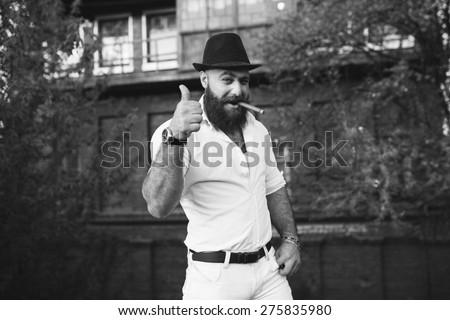 bearded italian boss smoke the cigar, black and white