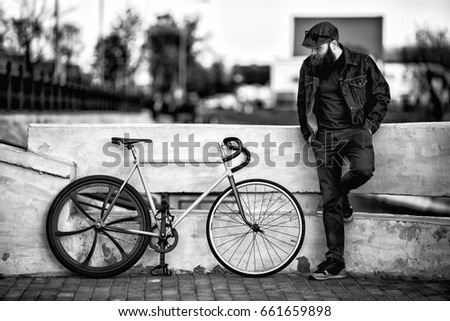 bearded man and fix bike. young ...
