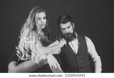 Bearded man and sexy woman with long curly hair. Woman with razor, scissors cut hair of man. Barbershop, fashion, beauty, hipster. Couple make haircut, love relations. Couple in love at hairdresser. #1310919293