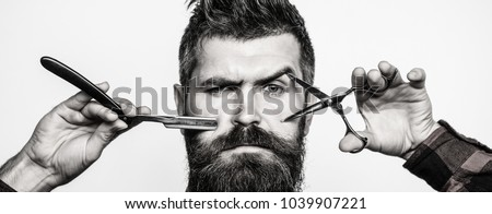Bearded man, bearded male. Portrait of stylish man beard. Barber scissors and straight razor, barber shop. Vintage barbershop, shaving. Black and white