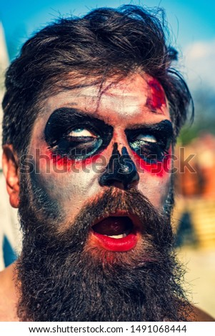 Scary Halloween Makeup For Guys With Beards.Shutterstock Puzzlepix