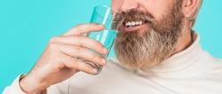 Bearded man drinking water. Man water.