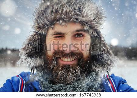bearded man in winter hat...