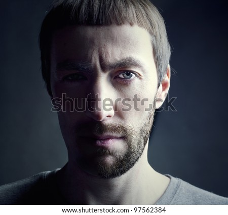 bearded man portrait, lit from the side