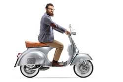 Bearded man riding a vintage scooter isolated on white background
