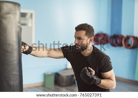 bearded man training with...