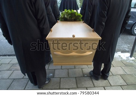 Bearers a carrying a coffin