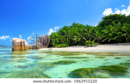 Beatiful beach Anse Source d'Argent with big granite rocks in sunny day. La Digue Island, Seychelles. Tropical destination. Photo stock ©