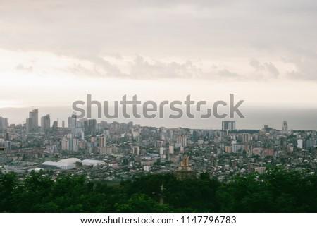 Beatiful colorful Georgian cityscape of Batumi. Panoramic view. Grey clouds over calm Black Sea #1147796783