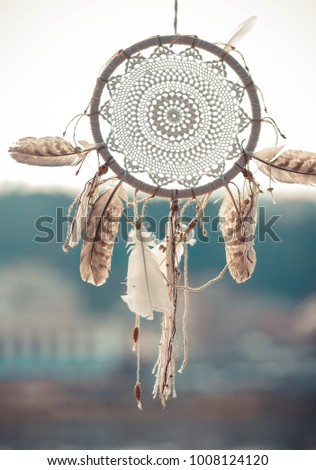 Beatiful dreamcatcher is moving on the wind. Boho chic style decoration #1008124120