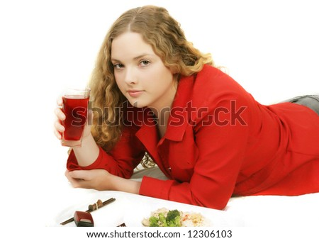 beatiful girl with glass of juice vand food  looking to the photographer