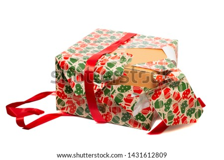 Beatifully wrapped present being unwrapped isolated on a white background.