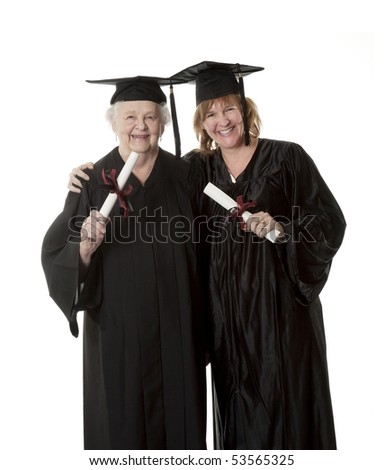 Beauitiful Caucasian woman in a black graduation gown