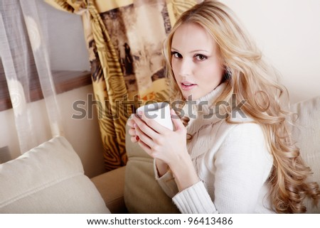 Beauriful girl drinking coffee at home