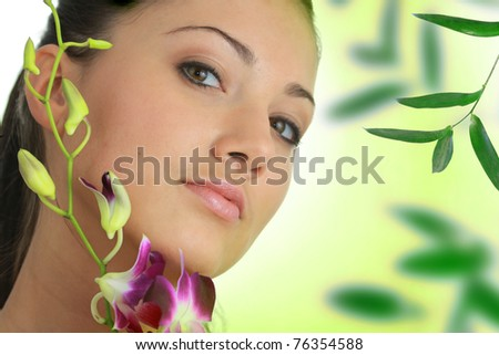 Beauteful spa girl with orchid