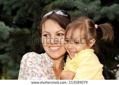 Beauteous young woman brought to walk her little daughter