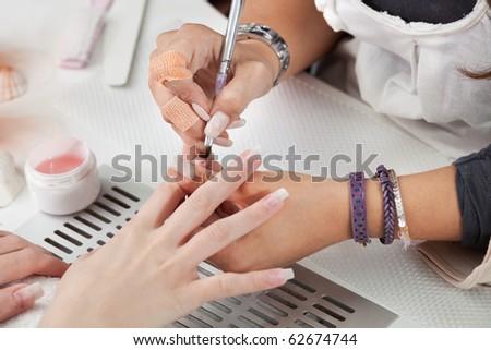 Beautician applying gel