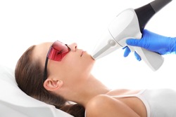 Beautician, laser hair removal. Cosmetic clinic, a woman during laser hair removal facial
