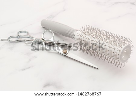 Beautician tool kit, feminine elegance and hair salon concept theme with close up on hair brush, pair of regular scissors and thinning shears isolated on white marble background