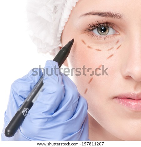 Beautician touch and draw correction lines on woman face Before plastic surgery operetion Isolated on white