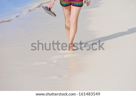 beautifel and happy woman girl on beach have fun and relax on summer vacation  over the beautiful tropical sea #161483549
