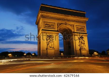 Beautifluly lit Triumph Arch at night. Paris, France.