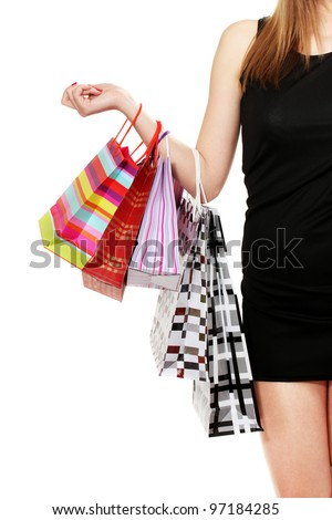 beautifu woman with shopping bags isolated on white