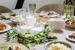Beautiful ablaze candle, luxury catering, wedding table. Clouse-up.