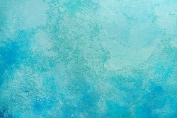 Beautiful abstract grunge decorative light blue cyan painted stucco wall texture. Handmade rough paper wide background with copy space