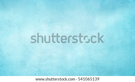 Beautiful Abstract Grunge Decorative Light Blue Cyan Painted Stucco Wall Texture. Handmade Rough Winter Christmas Paper Wide Background With Copy Space