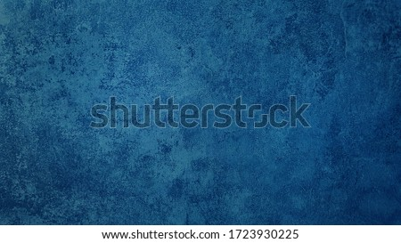 Photo of  beautiful abstract grungy blue stucco wall background in cold mood. pantone of the year color concept background with space for text.