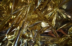 Beautiful Abstract Resplendent Gold Surface. Festive Background.