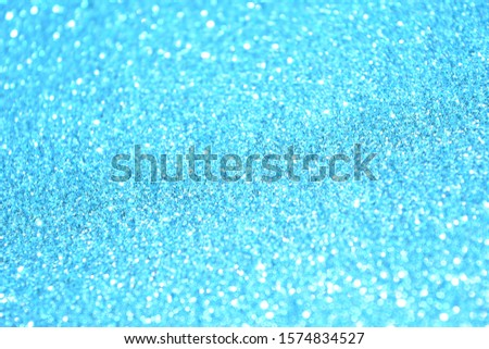 Beautiful Abstract Sparkle Glitter Lights Background. Sky Blue, Azure, Cerulean. Shine Bokeh Effect. For party, holidays, celebration. Good for New Year and Christmas Card. #1574834527