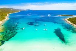 Beautiful Adriatic coast in Croatia. Aerial view of azure turquoise lagoon on Sakarun beach on Dugi Otok island, Croatia, yachts anchored in clear sea water.