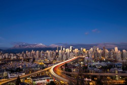 Beautiful aerial cityscape view of Vancouver Downtown, BC, Canada. Picture taken on a cloudy winter sunset.