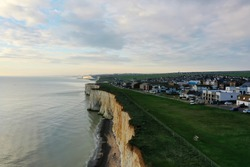 beautiful aerial cliff edge and calm ocean with town and beach at Peacehaven on the south coast of England