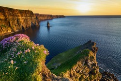beautiful aerial drone birds eye view cliffs of moher sunset in county clare ireland. tourist attraction along the wild atlantic way unesco global geopark. European Atlantic Geotourism Route