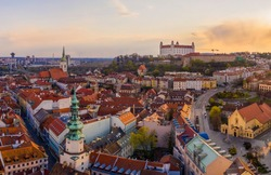 Beautiful aerial drone photo of Bratislava old town historical city center with Castle, St. Martin's Cathedral, Michael's Gate and UFO observation deck from above. Top view of capital of Slovakia.