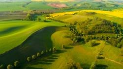 Beautiful aerial landscape in Moravia, Czech Republic. Sunrise over rolling hills in Moravia, aerial drone view.