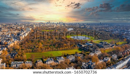 Beautiful aerial London view from above with the Hyde park in sight surrounded by a magical city of London with many buildings and narrow streets