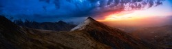 Beautiful Aerial Panoramic View of Dramatic Mountains and Scenic Alpine Lake during Fall in Canadian Nature. Dramatic Colorful Sunset Artistic Render. Tombstone Territorial Park, Yukon, Canada.