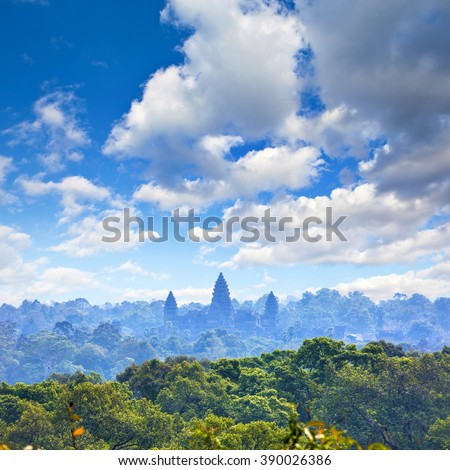 Beautiful aerial view of Angkor Wat Temple towers ascending from the jungles, Siem Reap, Cambodia #390026386
