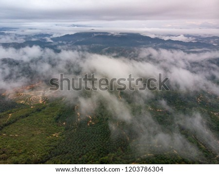 Beautiful aerial view of peak of the hills with clouds. #1203786304