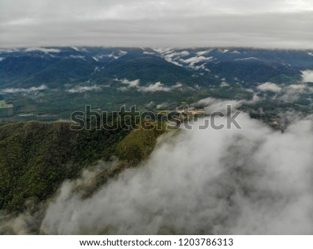 Beautiful aerial view of peak of the hills with clouds. #1203786313