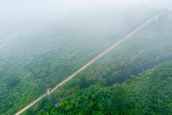 Beautiful aerial view of stairway toward Galunggung mountain peak at misty morning in Tasikmalaya, West Java, Indonesia