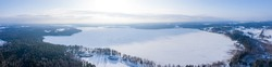 Beautiful aerial view of the huge frozen lake in the middle of a forest in Latvia. Frozen Ungurs lake in Latvia.