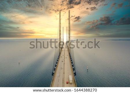 Photo of  Beautiful aerial view of the Oresundsbron bridge between Denmark and Sweden, Oresundsbron. Oresund Bridge close up view at sunset.
