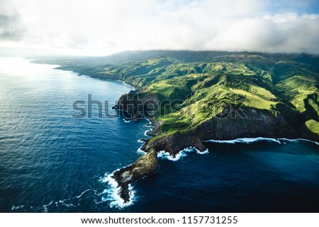 Photo of  Beautiful Aerial View of Tropical Island Paradise Nature Scene of Maui Hawaii On Clear Sunny Day with Vibrant Blue Ocean Water and Waves and Lush Green Mountain Scenic Landscape