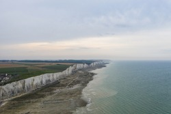 Beautiful aerial view on cliffs in the village of Ault in the department of Somme in France. Splendid panoramic view of french cliffs and La Manche coast, cloudy weather. Beautiful landscapes.