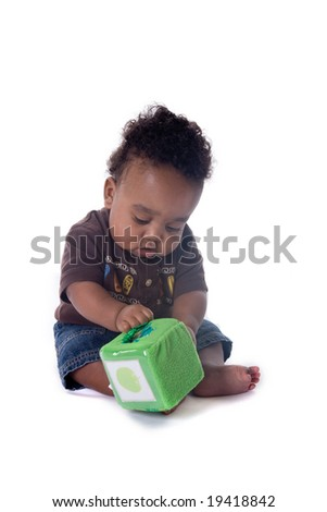Beautiful African american baby boy playing with a toy on white background